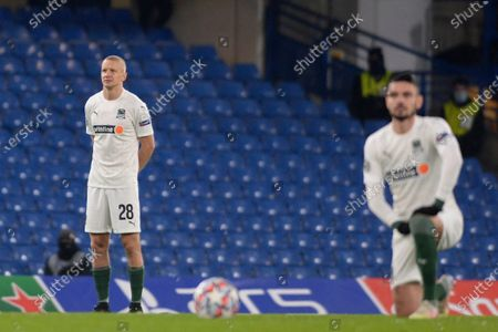 Igor Smolnikov of FC Krasnodar stands while players take a knee prior to UEFA Champions League group stage match between Chelsea and FC Krasnodar at The Hive in London, UK - 8th December 2020