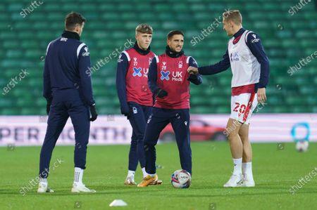 Michael Dawson of Nottingham Forest (20) and Anthony Knockaert (28) warm-up