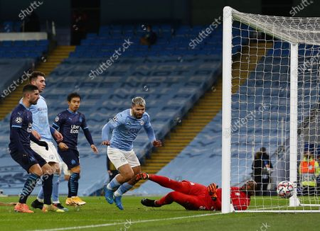 Sergio Aguero of Manchester City scores a goal to make it 2-0