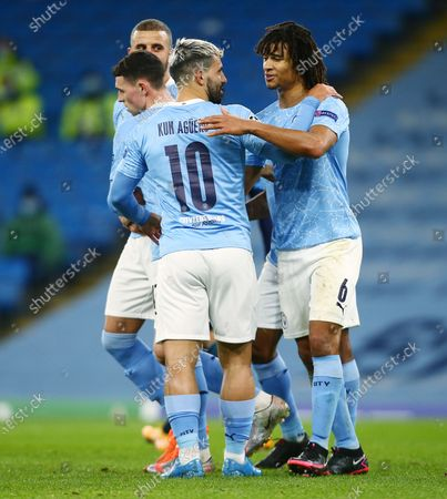 Sergio Aguero of Manchester City celebrates scoring a goal to make it 3-0 with Nathan Ake