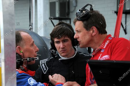 17-20 March 2010, Sebring, Florida, USA Genoa Racing team drivers Andy Wallace (l), and J R. Hildebrand (c), talk with one of the engineers. ©2010, Paul Webb, USA LAT Photographic