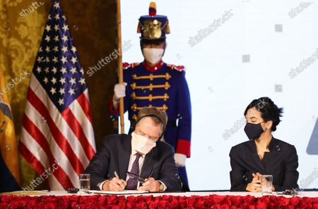 The United States Trade Representative, Robert Lighthizer (L), together with Vice President María Alejandra Muñoz (R), signs the document of the Signing of the Phase I Agreement called 'Protocol to the Agreement of the Council of Commerce and Investments between the USA and Ecuador related to commercial norms and transparency', in Quito, Ecuador, 08 December 2020. The International Development Corporation of the United States (DFC) signed with the Government of Ecuador an agreement by which it analyzes to allocate 700 million dollars to be channeled as credits to micro, small and medium-sized enterprises (MSMEs) in the country South American. The agreement, signed in Quito, will be aimed at the national private bank with the objective of promoting loans to small companies, mainly to women who start businesses and that, in turn, promote job creation, reported the General Secretariat of Government communication in a statement.