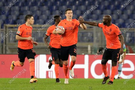 Brugge's Hans Vanaken, center, celebrates with Eder Balanta after scoring his side's 2nd goal during the Champions League, group F soccer match between Lazio and Club Brugge, at the Rome Olympic Stadium