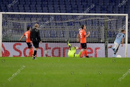 Brugge's goalkeeper Simon Mignolet fails to save the ball for Lazio's oaquin Correa to score, during the Champions League, group F soccer match between Lazio and Club Brugge, at the Rome Olympic Stadium