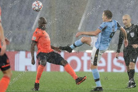 Brugge's Eder Balanta, left, and Lazio's Lucas Leiva fight for the ball during the Champions League, group F soccer match between Lazio and Club Brugge, at the Rome Olympic Stadium