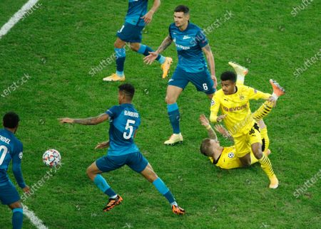 Dortmund's Marco Reus, second from right, and Ansgar Knauff, fight for the ball with Zenit's Wilmar Barrios, center left, and Dejan Lovren, center, during the Champions League group F soccer match between Zenit St.Petersburg and Borussia Dortmund at the Saint Petersburg stadium in St. Petersburg, Russia
