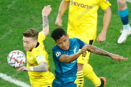 Dortmund's Marco Reus, left, and Zenit's Wilmar Barrios jump for the ball during the Champions League group F soccer match between Zenit St.Petersburg and Borussia Dortmund at the Saint Petersburg stadium in St. Petersburg, Russia