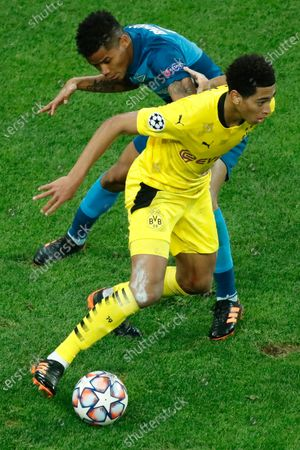 Zenit's Wilmar Barrios, left, and Dortmund's Jude Bellingham fight for the ball during the Champions League group F soccer match between Zenit St.Petersburg and Borussia Dortmund at the Saint Petersburg stadium in St. Petersburg, Russia
