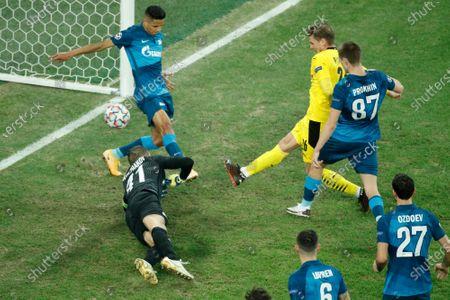 Dortmund's Lukasz Piszczek, center, scores their side's first goal past Zenit's goalkeeper Mikhail Kerzhakov, left low, during the Champions League group F soccer match between Zenit St.Petersburg and Borussia Dortmund at the Saint Petersburg stadium in St. Petersburg, Russia