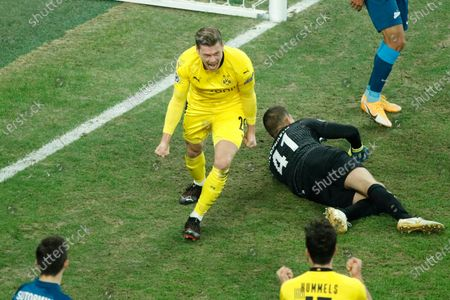 Dortmund's Lukasz Piszczek, center, celebrates after scoring his side's first goal past Zenit's goalkeeper Mikhail Kerzhakov, right, during the Champions League group F soccer match between Zenit St.Petersburg and Borussia Dortmund at the Saint Petersburg stadium in St. Petersburg, Russia