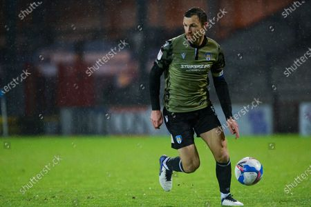 Colchester United Thomas Smith (5) controls the ball during the EFL Sky Bet League 2 match between Scunthorpe United and Colchester United at the Sands Venue Stadium, Scunthorpe