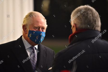 Prince Charles, Prince Charles wearing a protective face covering to combat the spread of the coronavirus, attends an event to thank local volunteers and key workers for the work they are doing during the coronavirus pandemic and over Christmas in the quadrangle of Windsor Castle in Windsor, west of London, on December 8, 2020 - The Queen and members of the royal family gave thanks to local volunteers and key workers for their work in helping others during the coronavirus pandemic and over Christmas at Windsor Castle in what was also the final stop for the Duke and Catherine Duchess of Cambridge on their tour of England, Wales and Scotland.