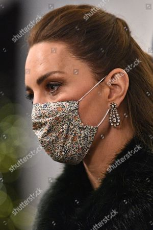 Catherine Duchess of Cambridge, wearing a protective face coverings to combat the spread of the coronavirus, attends an event to thank local volunteers and key workers for the work they are doing during the coronavirus pandemic and over Christmas in the quadrangle of Windsor Castle in Windsor, west of London, on December 8, 2020 - The Queen and members of the royal family gave thanks to local volunteers and key workers for their work in helping others during the coronavirus pandemic and over Christmas at Windsor Castle in what was also the final stop for the Duke and Catherine Duchess of Cambridge on their tour of England, Wales and Scotland.