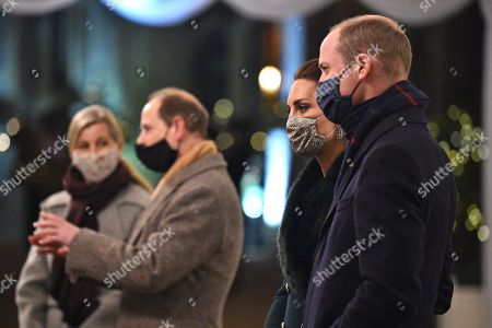 Prince William, Prince William, (R) and Catherine Duchess of Cambridge, (2nd R), wearing protective face coverings to combat the spread of the coronavirus, attend an event to thank local volunteers and key workers for the work they are doing during the coronavirus pandemic and over Christmas in the quadrangle of Windsor Castle in Windsor, west of London, on December 8, 2020 - The Queen and members of the royal family gave thanks to local volunteers and key workers for their work in helping others during the coronavirus pandemic and over Christmas at Windsor Castle in what was also the final stop for the Duke and Catherine Duchess of Cambridge on their tour of England, Wales and Scotland.