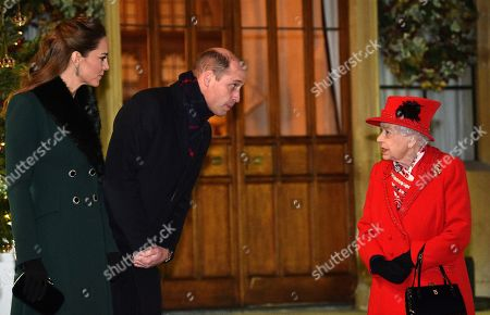 Queen Elizabeth II (R) talks with Prince William, Prince William, (2L) and Catherine Duchess of Cambridge, as they wait to thank local volunteers and key workers for the work they are doing during the coronavirus pandemic and over Christmas in the quadrangle of Windsor Castle in Windsor, west of London, on December 8, 2020 - The Queen and members of the royal family gave thanks to local volunteers and key workers for their work in helping others during the coronavirus pandemic and over Christmas at Windsor Castle in what was also the final stop for the Duke and Catherine Duchess of Cambridge on their tour of England, Wales and Scotland.
