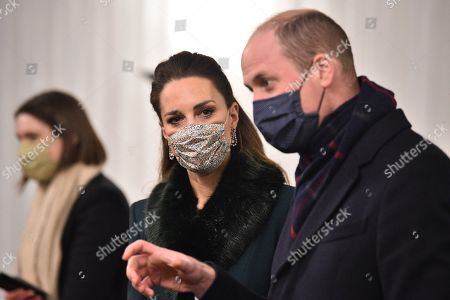 Prince William, Prince William, (R) and Catherine Duchess of Cambridge (C), wearing protective face coverings to combat the spread of the coronavirus, attend an event to thank local volunteers and key workers for the work they are doing during the coronavirus pandemic and over Christmas in the quadrangle of Windsor Castle in Windsor, west of London, on December 8, 2020 - The Queen and members of the royal family gave thanks to local volunteers and key workers for their work in helping others during the coronavirus pandemic and over Christmas at Windsor Castle in what was also the final stop for the Duke and Catherine Duchess of Cambridge on their tour of England, Wales and Scotland.