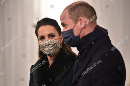 Prince William, Prince William, (R) and Catherine Duchess of Cambridge (L), wearing protective face coverings to combat the spread of the coronavirus, attend an event to thank local volunteers and key workers for the work they are doing during the coronavirus pandemic and over Christmas in the quadrangle of Windsor Castle in Windsor, west of London, on December 8, 2020 - The Queen and members of the royal family gave thanks to local volunteers and key workers for their work in helping others during the coronavirus pandemic and over Christmas at Windsor Castle in what was also the final stop for the Duke and Catherine Duchess of Cambridge on their tour of England, Wales and Scotland.
