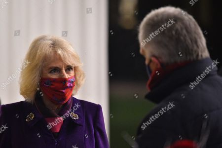 Camilla, Camilla Duchess of Cornwall wearing a protective face covering to combat the spread of the coronavirus, attends an event to thank local volunteers and key workers for the work they are doing during the coronavirus pandemic and over Christmas in the quadrangle of Windsor Castle in Windsor, west of London, on December 8, 2020 - The Queen and members of the royal family gave thanks to local volunteers and key workers for their work in helping others during the coronavirus pandemic and over Christmas at Windsor Castle in what was also the final stop for the Duke and Catherine Duchess of Cambridge on their tour of England, Wales and Scotland.