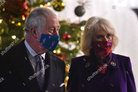 Prince Charles, Prince Charles (L) and Camilla, Camilla Duchess of Cornwall (R) attend an event to thank local volunteers and key workers for the work they are doing during the coronavirus pandemic and over Christmas in the quadrangle of Windsor Castle in Windsor, west of London, on December 8, 2020 - The Queen and members of the royal family gave thanks to local volunteers and key workers for their work in helping others during the coronavirus pandemic and over Christmas at Windsor Castle in what was also the final stop for the Duke and Catherine Duchess of Cambridge on their tour of England, Wales and Scotland.