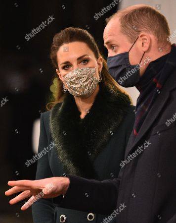 Stock Picture of Prince William, Prince William, (R) and Catherine Duchess of Cambridge (L), wearing protective face coverings to combat the spread of the coronavirus, attend an event to thank local volunteers and key workers for the work they are doing during the coronavirus pandemic and over Christmas in the quadrangle of Windsor Castle in Windsor, west of London, on December 8, 2020 - The Queen and members of the royal family gave thanks to local volunteers and key workers for their work in helping others during the coronavirus pandemic and over Christmas at Windsor Castle in what was also the final stop for the Duke and Catherine Duchess of Cambridge on their tour of England, Wales and Scotland.