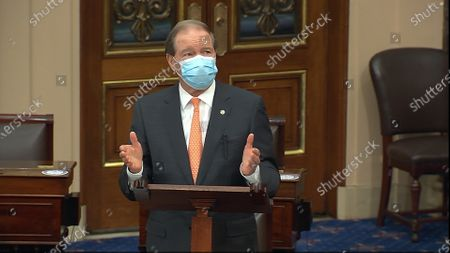 In this image from video, retiring Sen. Tom Udall, D-N.M., speaks on the floor of the U.S. Senate, on Capitol Hill in Washington. A plan championed by Udall harness the nation's lands and ocean waters to fight climate change is getting a boost from Joe Biden. The president-elect has made slowing global warming a priority for his incoming administration