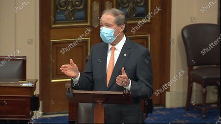 Stock Image of In this image from video, retiring Sen. Tom Udall, D-N.M., speaks on the floor of the U.S. Senate, on Capitol Hill in Washington. A plan championed by Udall harness the nation's lands and ocean waters to fight climate change is getting a boost from Joe Biden. The president-elect has made slowing global warming a priority for his incoming administration
