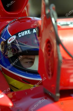 Stock Photo of Buzz Cawkins sits in the cooling air of a fan on a typically hot Georgia day. IRNLS Atlanta 500 Classic, Atlanta Motor Speedway, Hampton, Georgia, USA 28 April,2001 Copyright-F Peirce Williams 2001 LAT PHOTOGRAPHIC