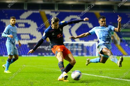 Harry Cornick of Luton Town fires in a shot, blocked for a corner by Sam McCallum of Coventry City (on loan from Norwich City)