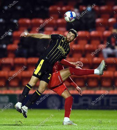 Mark Little of Bristol Rovers heads the ball