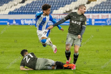 Huddersfield Town AFC Forward Josh Koroma (19) is tackled by Sheffield Wednesday FC Midfielder Massimo Luongo (21) during the EFL Sky Bet Championship match between Huddersfield Town and Sheffield Wednesday at the John Smiths Stadium, Huddersfield