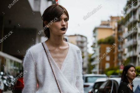 Stock Photo of Model Lara Mullen wears white cashmere sweater, outside Max Mara show during Milan Fashion Week Womenswear Spring Summer 2020