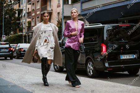 Ann Kathrin Goetze and Mandy Bork wearing complete Max Mara looks, outside Max Mara show during Milan Fashion Week Womenswear Spring Summer 2020