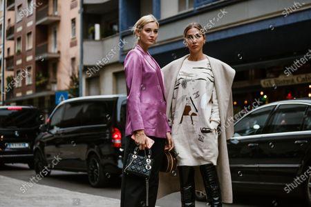 Mandy Bork and Ann Kathrin Goetze wearing complete Max Mara looks, outside Max Mara show during Milan Fashion Week Womenswear Spring Summer 2020
