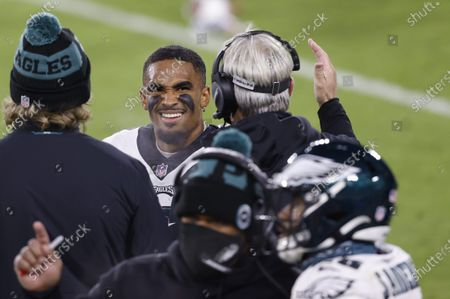 Philadelphia Eagles' Jalen Hurts, center, talks with Head coach Doug Pederson during an NFL football game, Sunday, Dec 6. 2020, between the Philadelphia Eagles and Green Bay Packers in Green Bay, Wis