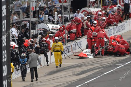 25 May 2008, Indianapolis, Indiana, USA. Danica Patrick stopped on way to #6 car by IRL secruity's Charles Burns after pitlane crash with Ryan Briscoe 2008© Dan R. Boyd. USA LAT Photographic
