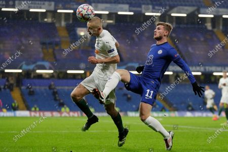 Igor Smolnikov of FC Krasnodar (L) and Timo Werner of Chelsea FC (R) in action during the UEFA Champions League group E soccer match between Chelsea FC and FC Krasnodar in London, Britain, 08 December 2020.