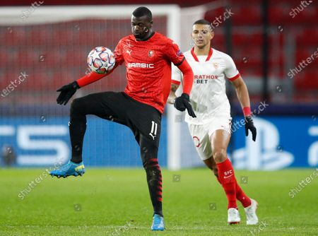 Rennes' M'Baye Niang (L) in action against Sevilla's Diego Carlos (R) during the UEFA Champions League group E soccer match between Stade Rennes and Sevilla FC in Rennes, France, 08 December 2020.