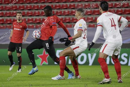 Rennes' M'Baye Niang, center left, controls the ball by Sevilla's Diego Carlos, center right, during the Champions League, group E soccer match between Rennes and Sevilla at the Roazhon Park stadium in Rennes, France