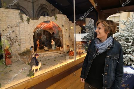 The mayor of Beziers Robert Menard poses with his wife the deputy Emmanuelle Menard in front of the new Christmas crib