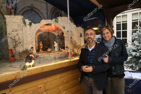 Stock Picture of The mayor of Beziers Robert Menard poses with his wife the deputy Emmanuelle Menard in front of the new Christmas crib