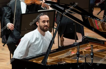 Russian-German pianist Igor Levit toghether with French conductor Stephane Deneve (not pictured) and the Royal Stockholm Philharmonic Orchestra perform Beethoven's Piano Concerto No. 5 (Emperor Concerto) during the televised Nobel Prize Concert 2020 at the Stockholm Concert Hall, in Stockholm, Sweden, 08 December 2020.