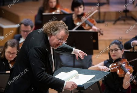 French conductor Stephane Deneve together with Russian-German pianist Igor Levit (unseen) and the Royal Stockholm Philharmonic Orchestra perform Beethoven's Piano Concerto No. 5 (Emperor Concerto) during the televised Nobel Prize Concert 2020 at the Stockholm Concert Hall, in Stockholm, Sweden, 08 December 2020.