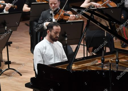 Russian-German pianist Igor Levit together with French conductor Stéphane Denève (not pictured) and the Royal Stockholm Philharmonic Orchestra perform Beethoven's Piano Concerto No. 5 (Emperor Concerto) during the Nobel Prize Concert 2020 at the Stockholm Concert Hall