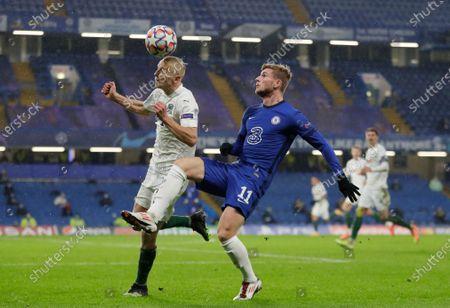 Chelsea's Timo Werner, right, challenges Krasnodar's Igor Smolnikov during the Champions League Group E soccer match between Chelsea and Krasnodar at Stamford Bridge stadium in London