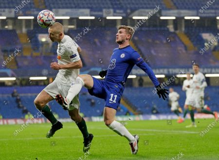 Stock Image of Chelsea's Timo Werner, right, challenges Krasnodar's Igor Smolnikov during the Champions League Group E soccer match between Chelsea and Krasnodar at Stamford Bridge stadium in London