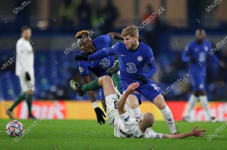 Chelsea's Timo Werner, right, and Chelsea's Tammy Abraham challenge Krasnodar's Igor Smolnikov during the Champions League Group E soccer match between Chelsea and Krasnodar at Stamford Bridge stadium in London