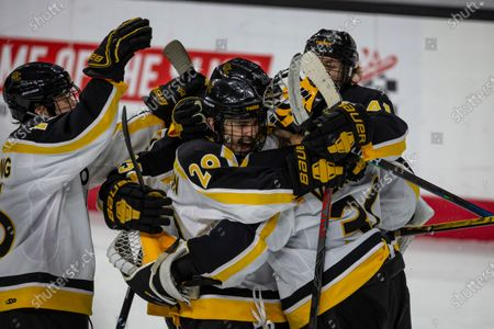 Colorado College forward Brian Hawkinson (29) hugs Colorado College goaltender Matt Vernon (30) after blocking a shot to win the shoot out against the Western Michigan during an NCAA hockey game, in Omaha, Neb
