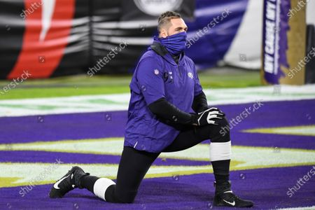 Baltimore Ravens defensive end Derek Wolfe (95) stretches before an NFL football game against the Dallas Cowboys, in Baltimore