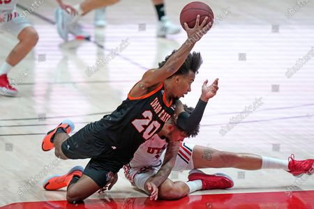 Idaho State guard Robert Ford III (20) and Utah forward Timmy Allen, rear, collide after going for a loose ball during the second half of an NCAA college basketball game, in Salt Lake City