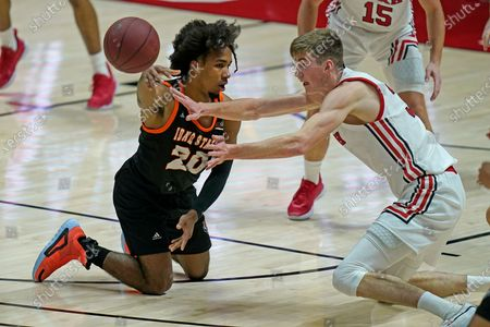 Idaho State guard Robert Ford III (20) passes the ball as Utah center Branden Carlson, right, defends during the second half of an NCAA college basketball game, in Salt Lake City